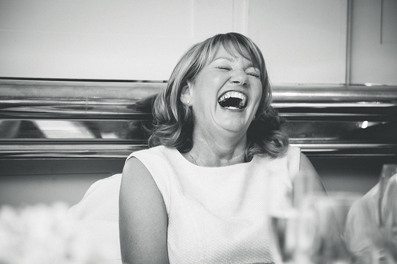 mother of the bride having a laugh at the manchester wedding