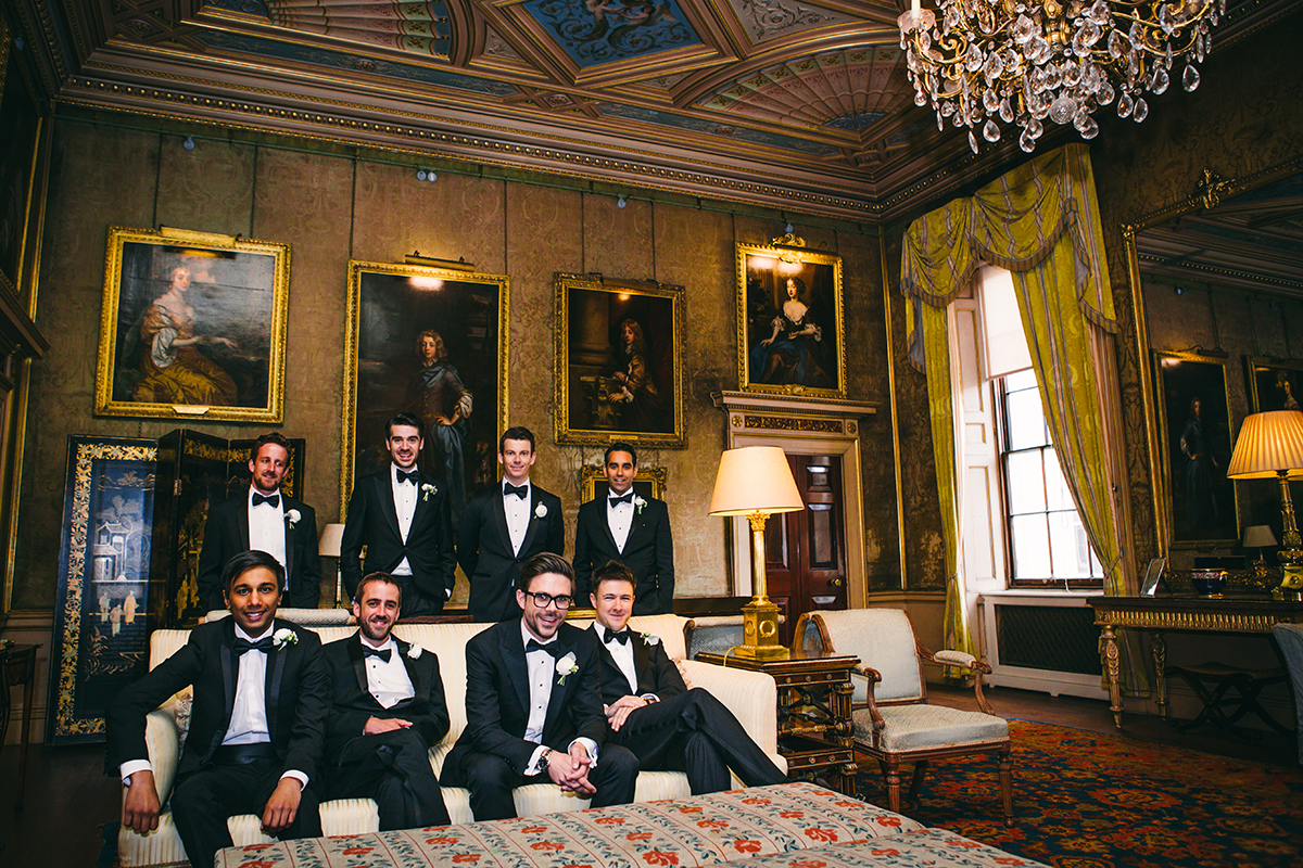 groomsmen in classical interior shot