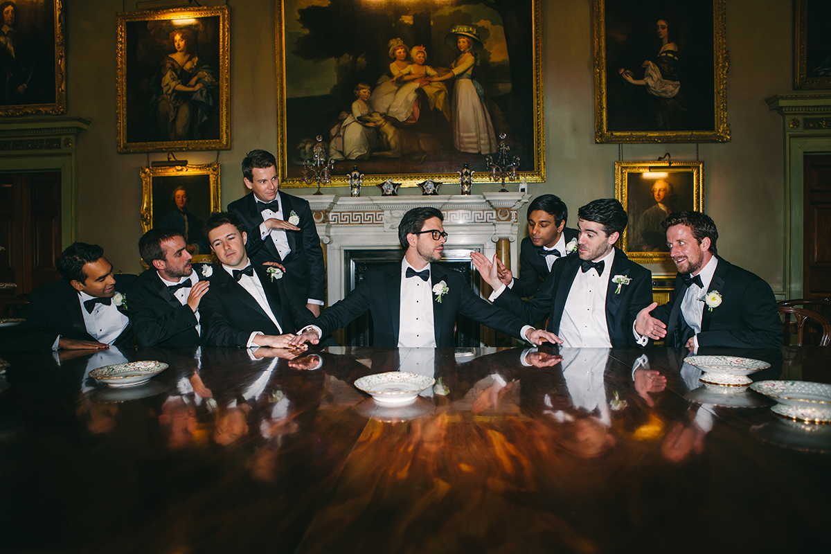 Groomsmen pose for last supper shot
