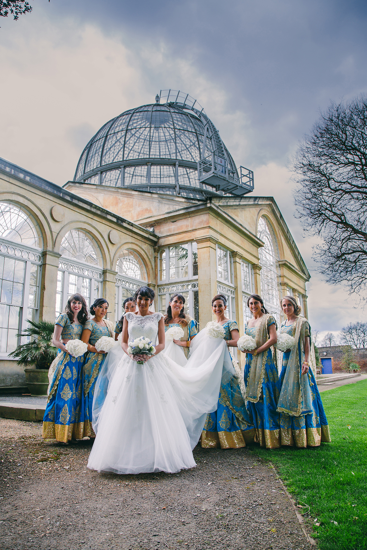 bride and bridesmaids walking with dome