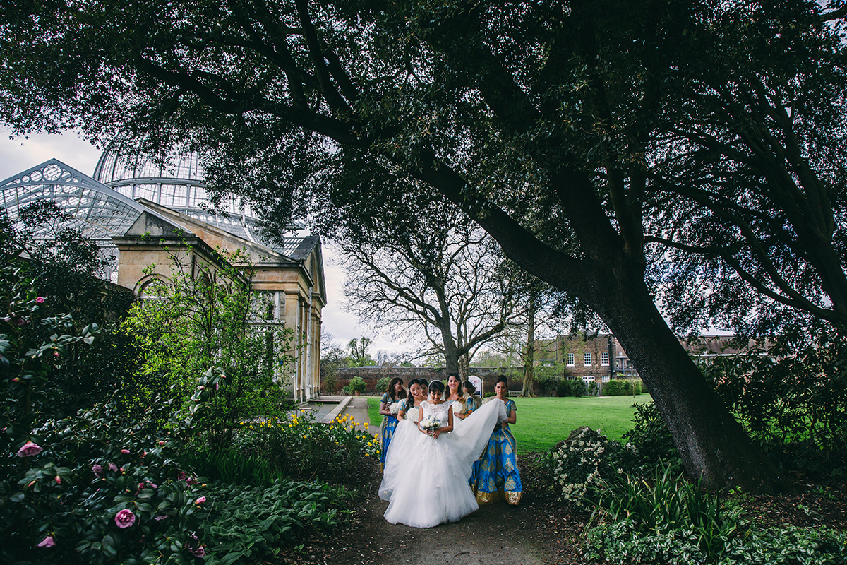 bride and bridesmaids walking in garden