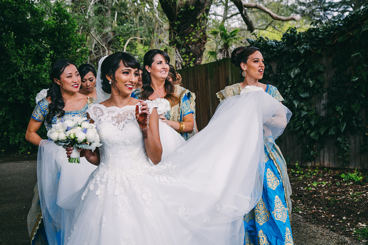 bride and bridesmaids on the move