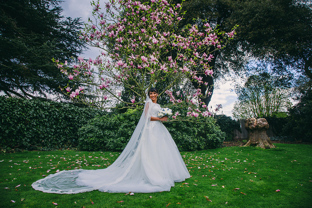 bride with magnolia tree