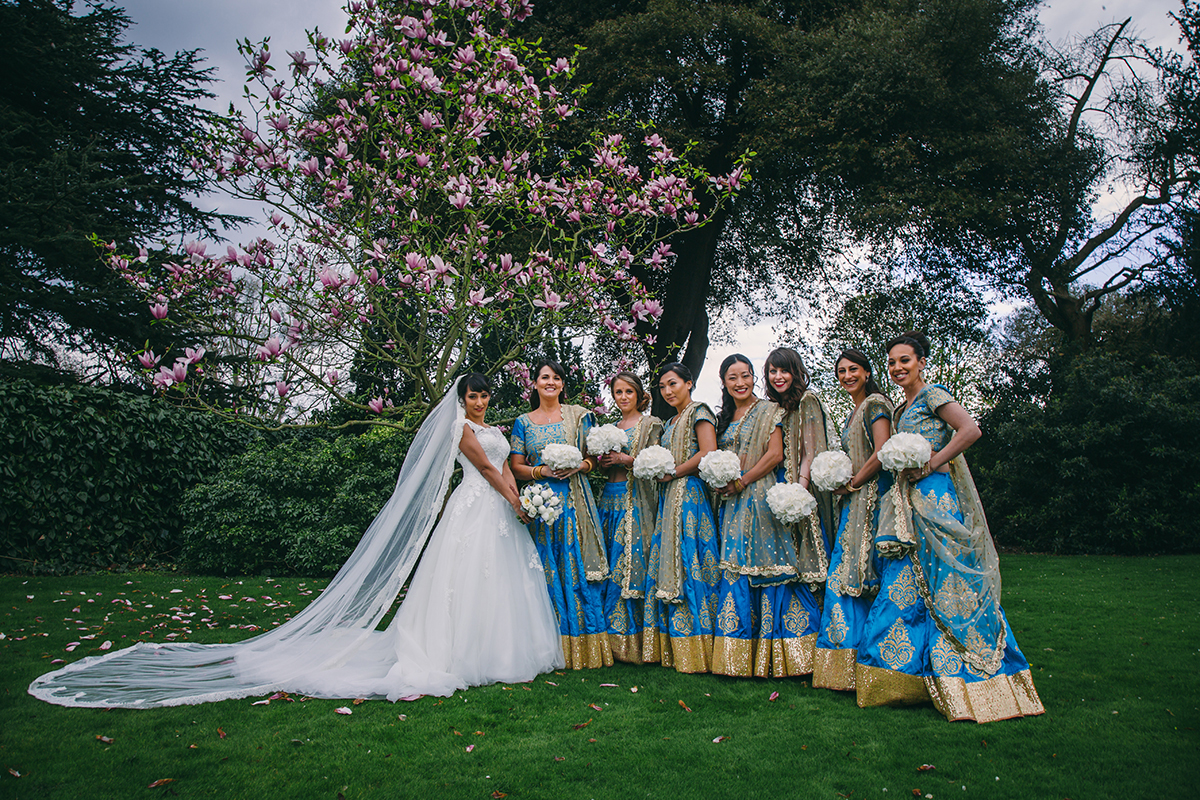 bride and bridesmaids with magnolia tree