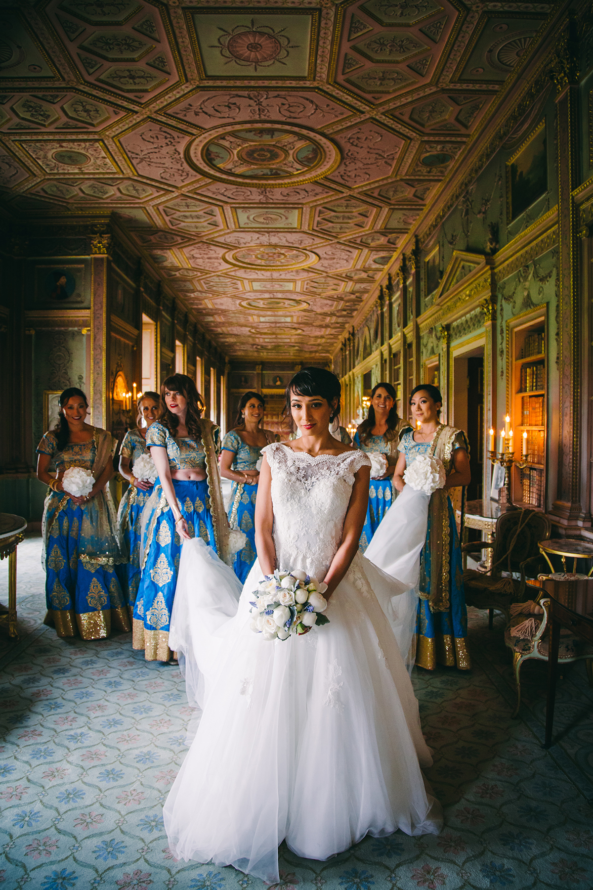 bride and bridesmaids in classical interior