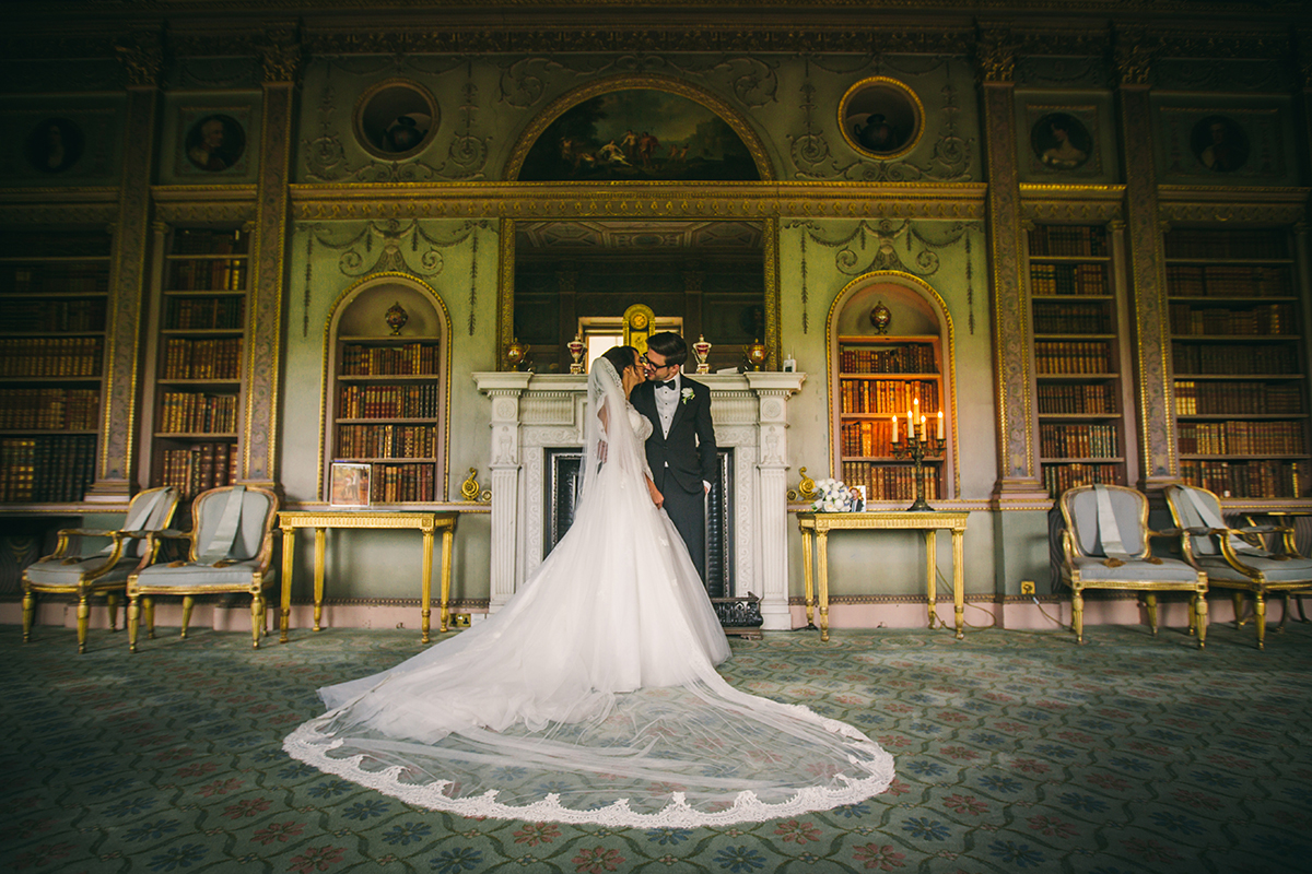 bride and groom in the library with the veil