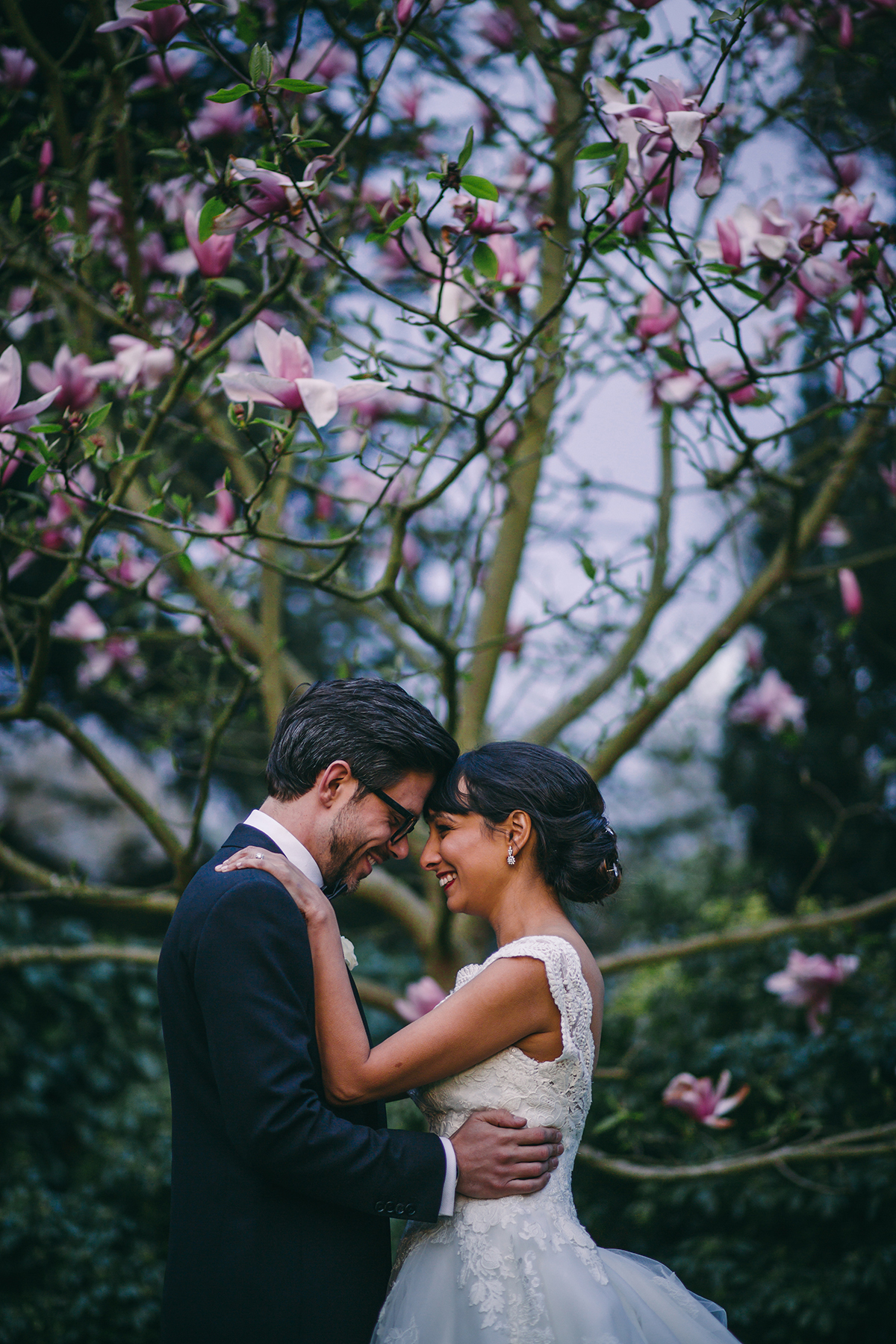 bride and groom with magnolia tree